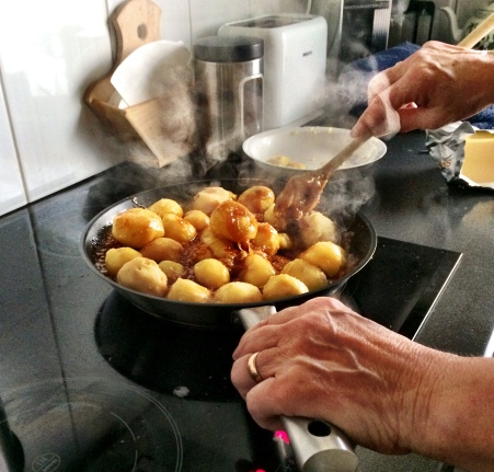 Boiled potatoes are added to a sticky caramel